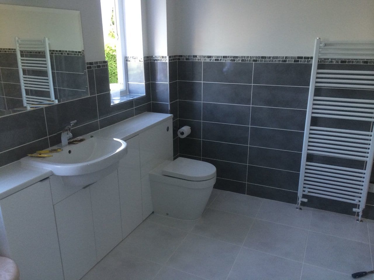 Bathroom fitted with Toilet and Towel Radiator in Leeds