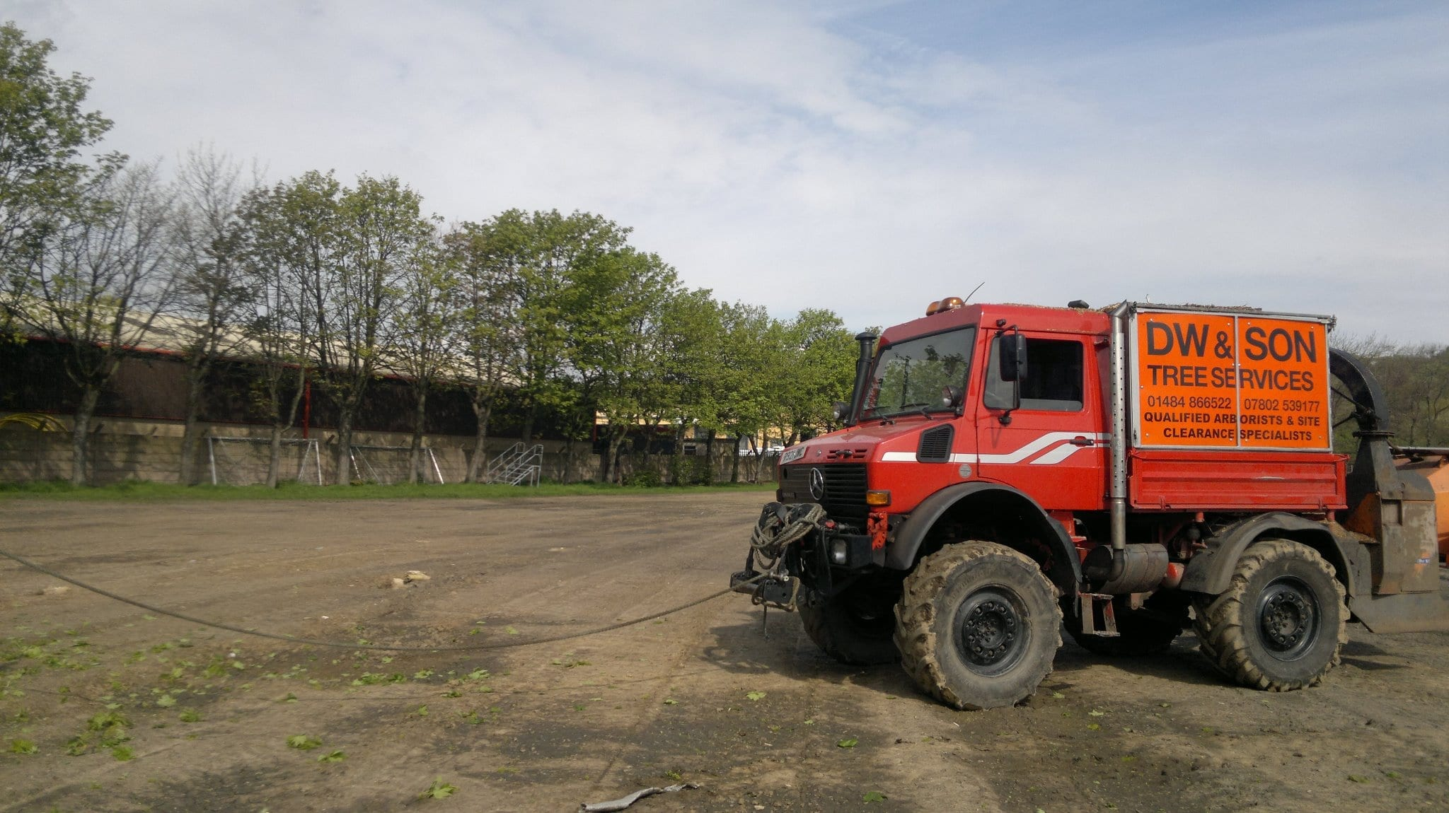 Tree surgeons Unimog with TPO powered wood chipper for chipping trees