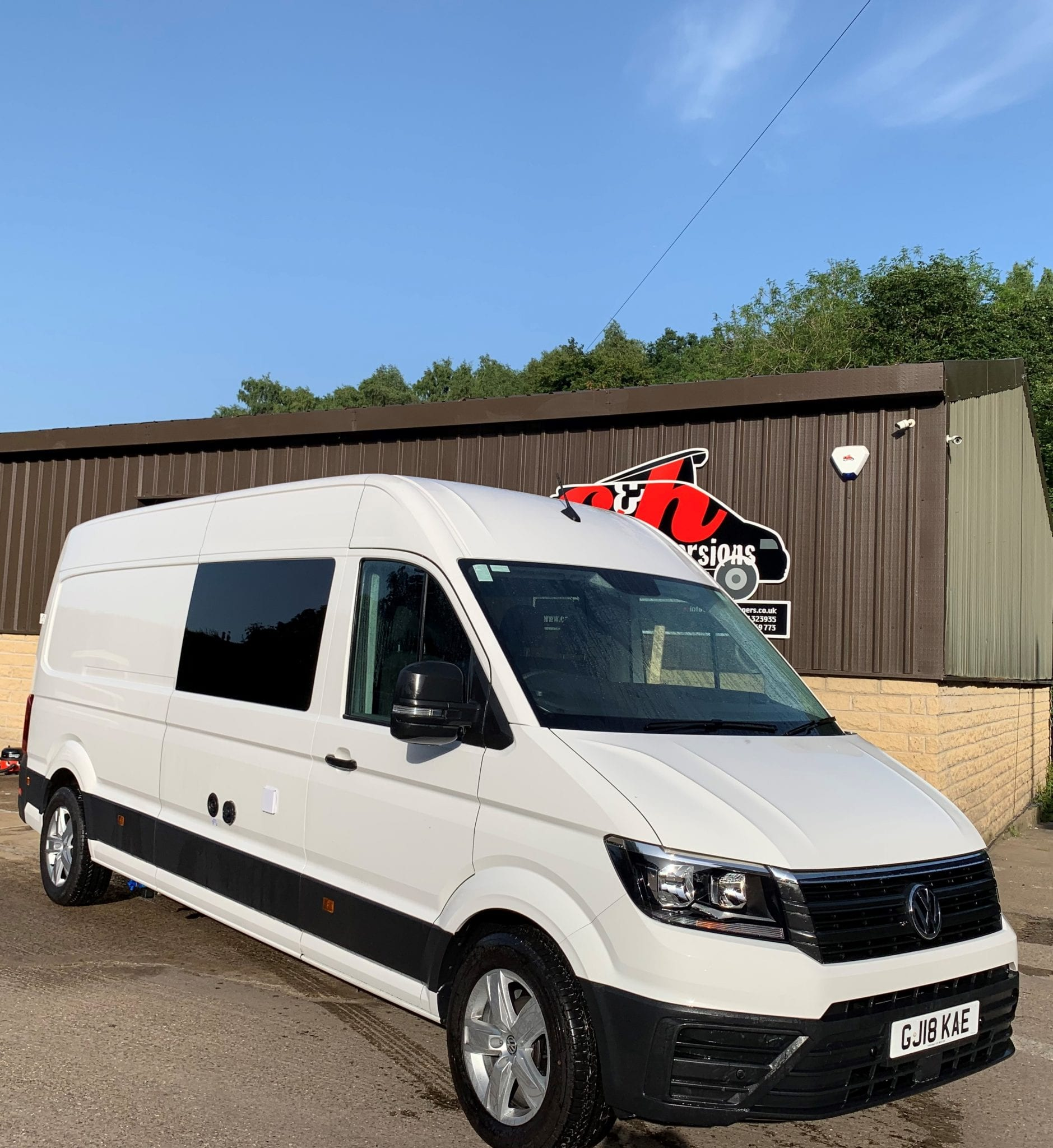 White VW Crafter Campervan Conversion with garage, toilet and shower front