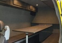 Transit van converted into camper van with beds and table