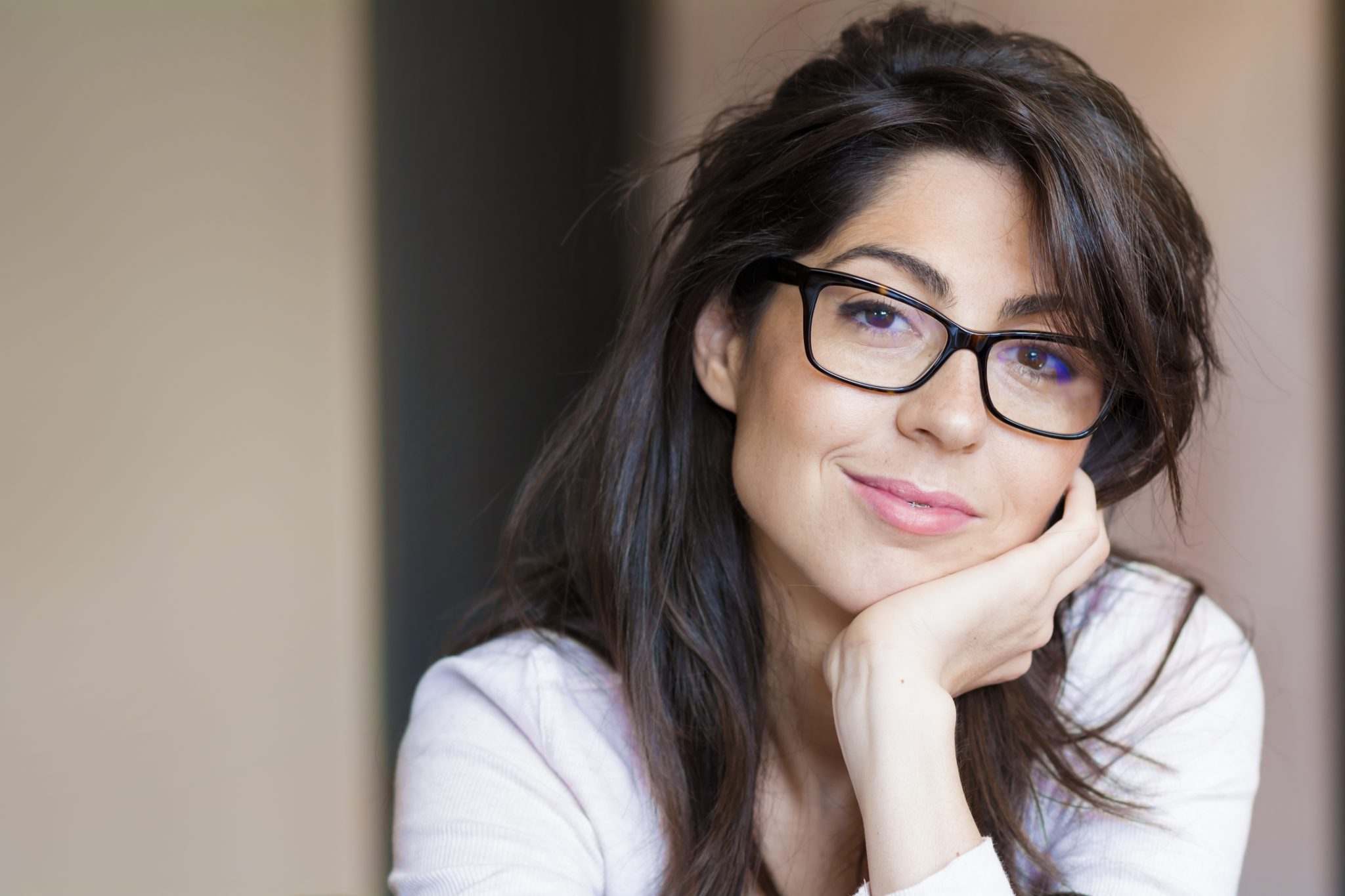 attractive lady resting head on hand wearing stylish glasses after visiting optician