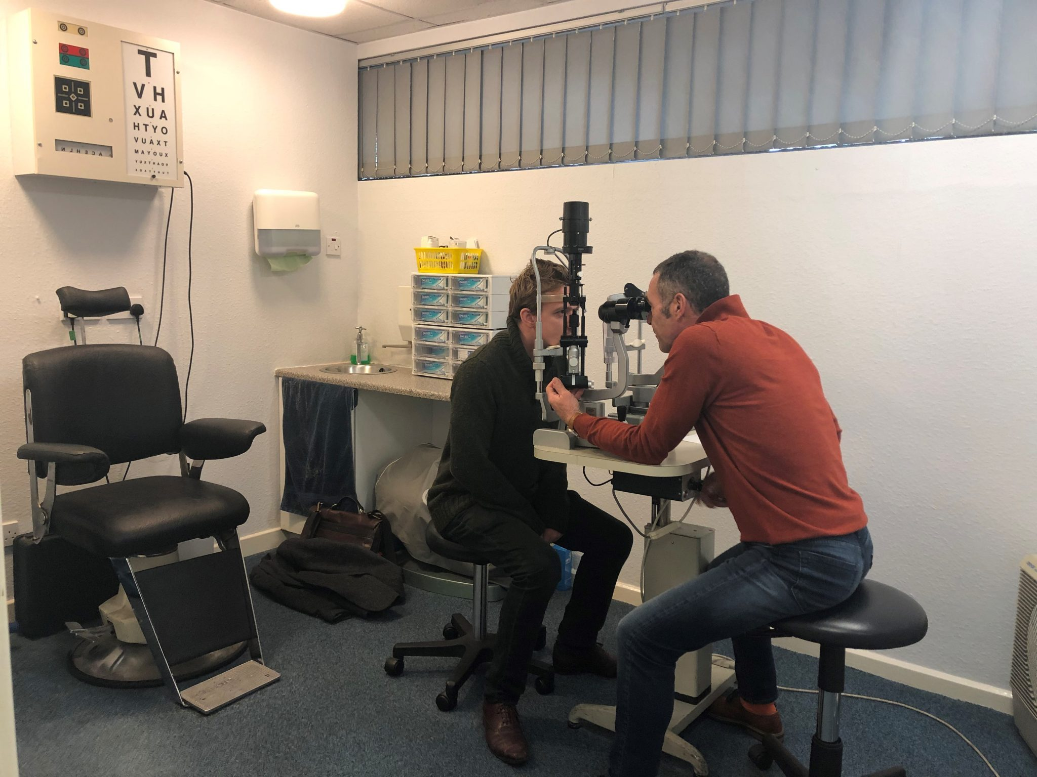 Optician Chris Checking Patients eye during a contact lense fitting in Barnsely