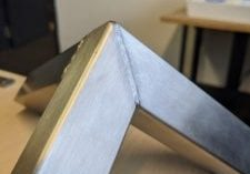a stainless steel cut after being cleaned with a TIG Bruch by PC Fabrications in Leeds