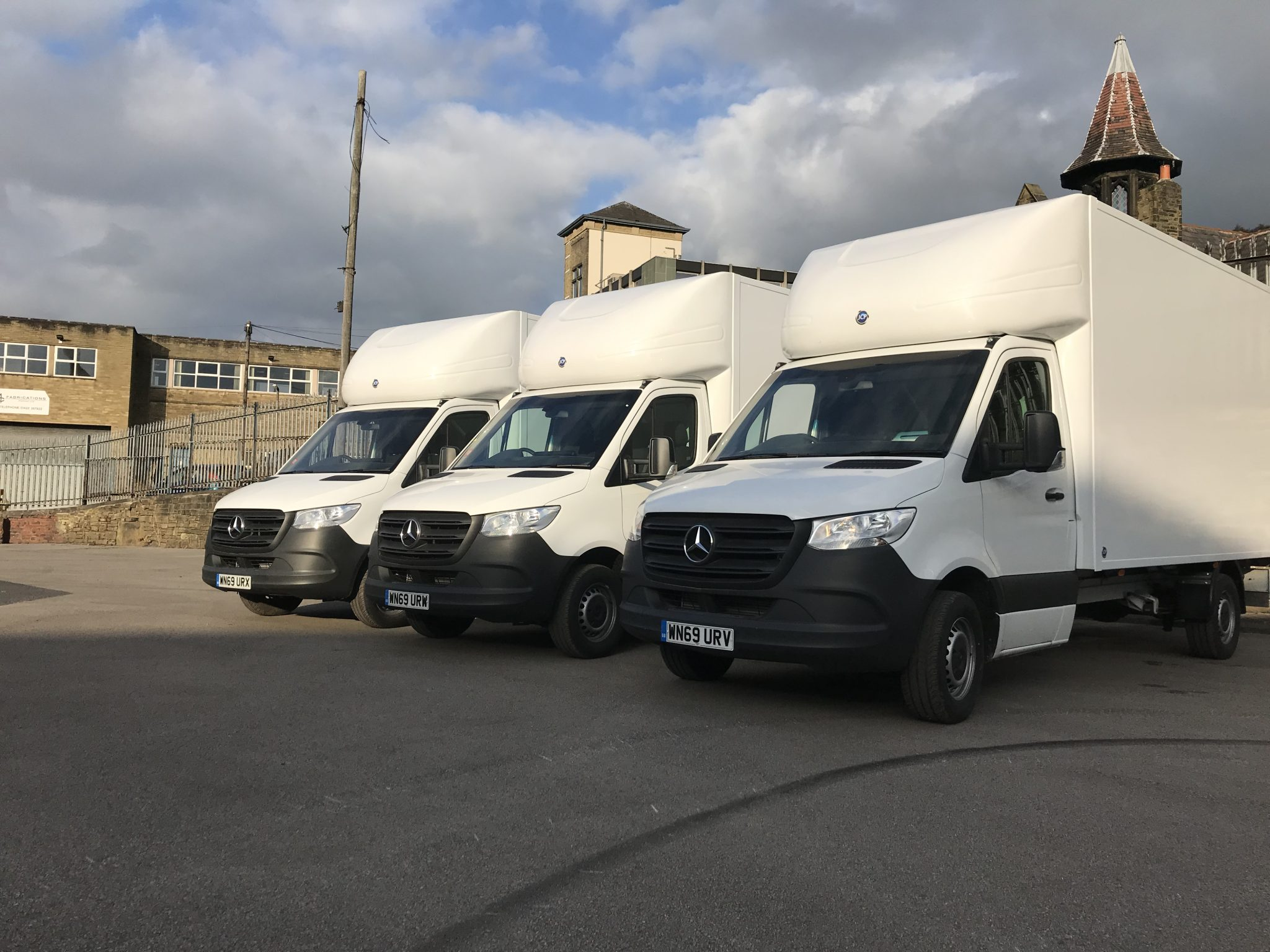 A fleet of white luton vans available for fleet services or lease