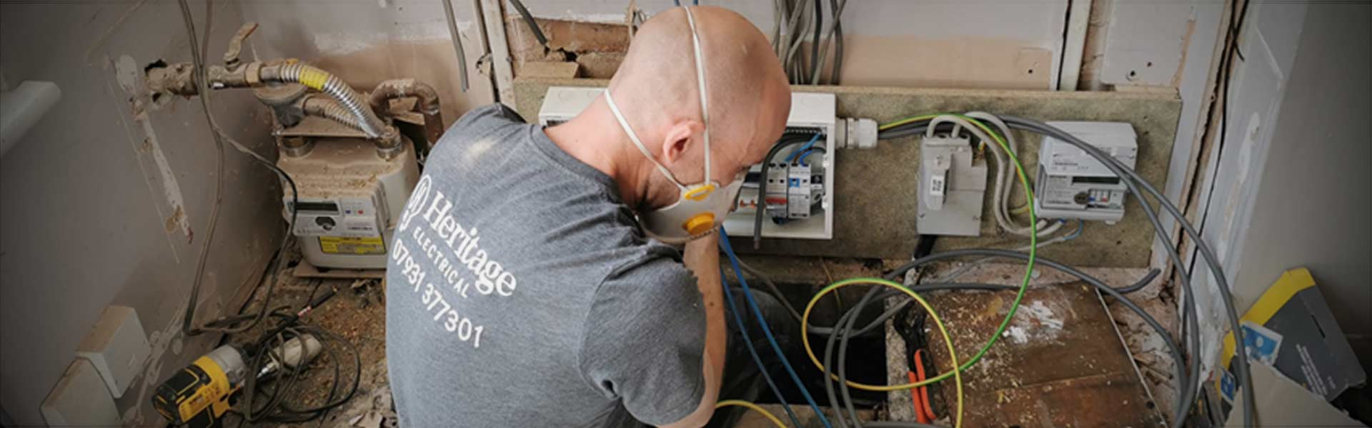 An electrician changing a consumer unit