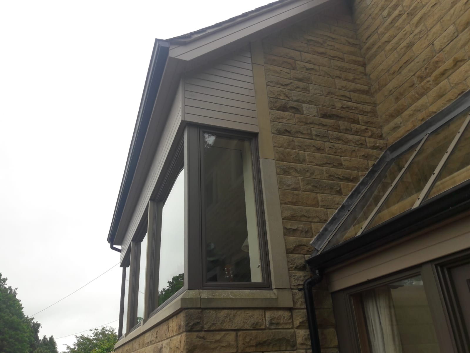 Exterior wood Cladding and window hand painted by professional Painter & Decorator Gareth Thompson in Cookridge, Leeds