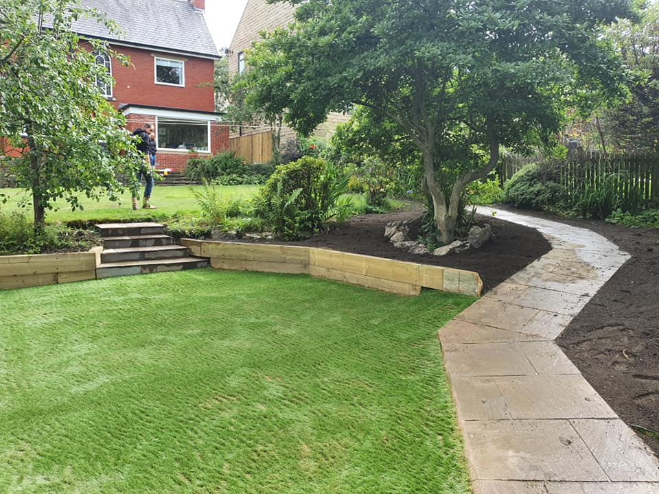 hard landscaping with Flagged pathway and turfing in Huddersfield